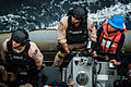 U.S. Sailors and Coast Guardsmen in a rigid-hull inflatable boat prepare to board the guided missile destroyer USS Stockdale (DDG 106) during a visit, board, search and seizure training exercise April 26, 2013 130426-N-HN991-047.jpg
