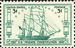 A postage stamp accurately depicts Constitution at sail. The ship sails to the right side of the stamp.