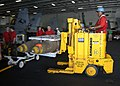 US Navy 020909-N-3653A-001 moving ordnance in the hangar bay.jpg