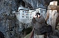 US Navy 030203-N-4953E-005 Photographer's Mate 2nd Class John Beeman takes a moment to photograph Slovenian Landscape during a guided Moral, Welfare, and Recreation (MWR) tour of Predjama Castle during a recent port visit.jpg