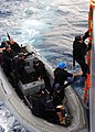 US Navy 040224-N-4374S-006 A member of the Vessel, Board, Search, and Seizure (VBSS) team assigned to the guided missile destroyer USS Roosevelt (DDG 80) climbs up on a ladder while boarding Training Support Vessel Prevail (TSV.jpg