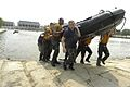 US Navy 040518-N-9693M-004 A squad of Midshipmen carry a rubber boat ashore as part of competition in Sea Trials.jpg