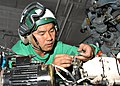 US Navy 040608-N-9871P-037 Aviation Electrician's Mate 2nd Class David Chau, from Long Island, N.Y., works on an SH-60 Seahawk helicopter.jpg