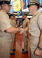US Navy 040916-N-3019M-001 Capt. Michael C. Vitale and Capt. Ronald R. Cox, congratulate new chief petty officers (CPO) during their induction into the CPO community at a pinning ceremony held on board Pearl Harbor.jpg