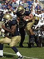 US Navy 040925-N-9693M-012 U.S. Naval Academy Midshipman 1st Class Kyle Eckel rushes through a pile of Vanderbilt defenders enroute to a two-point conversion run to put Navy up 22-19 midway through the third quarter.jpg