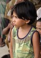 US Navy 050117-N-5362F-351 A young Indonesian child listens as United Nations (UN) World Health Organization (WHO) workers conduct a survey about relief supplies and medical attention needed in the village of Gunung Meunasah.jpg