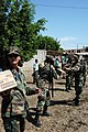 US Navy 050415-N-0507C-001 U.S. Navy Reserve Cmdr. Gail Myers, front, along with other members of Task Force New Horizons, delivers humanitarian relief supplies from the U.S. Navy's Project Handclasp.jpg