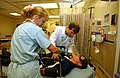 US Navy 050526-F-5586B-077 Shannon Bathurst, left, Emergency Medical Technician and John Hybart, Medical Director Emergency Department performs a medical evaluation to a simulated patient during exercise Lifesaver 2005.jpg