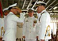 US Navy 050602-N-0716S-124 Capt. Peter Murphy, right, salutes Rear Adm. Michael LeFever before assuming duties as commanding officer (CO) of the amphibious assault ship USS Tarawa (LHA 1).jpg