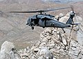 US Navy 050712-N-8629M-049 An HH-60G Pavehawk helicopter assigned to the United States Air Force's 41st Rescue Squadron conducts a training flight over parts of Nevada.jpg