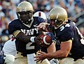 US Navy 050910-N-9693M-001 U.S. Naval Academy Midshipmen Quarterback Lamar Owens hands off to fullback Matt Hall in the first quarter of play against the Stanford Cardinals.jpg