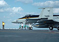 US Navy 051025-N-3488C-023 Aviation Boatswain Mate 2nd Class Paul Young directs an F-A-18E Super Hornet.jpg