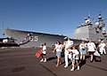US Navy 060109-N-3019M-009 Sailors assigned to the guided missile cruiser USS Chosin (CG 65), and their family members leave the pier.jpg