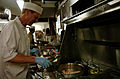 US Navy 060412-N-7711S-190 Commander, Carrier Strike Group Seven (CCSG-7) Rear Adm. Michael H. Miller prepares dinner for himself and his cooks in the flag mess aboard the Nimitz-class aircraft carrier USS Ronald Reagan (CVN 7.jpg