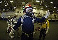 US Navy 060522-N-3136P-004 An on-scene leader directs hose teams during a simulated fire in the hangar bay of the conventionally-powered aircraft carrier USS Kitty Hawk (CV 63).jpg
