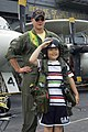 US Navy 060702-N-9864S-030 Lt. Chris Swanson assigned to Carrier Airborne Early Warning One One Five (VAW-115) poses with a young Japanese boy, whom he lent his helmet and flight gear.jpg