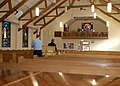 US Navy 061208-N-3901L-011 Religious Program Specialist 2nd Class John R. Miller and Religious Program Specialist 3rd Class Sonte Apollinare move pews in the Naval Air Station North Island chapel to prepare for its reopening De.jpg