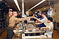 US Navy 070206-N-1831S-046 Kitchen staff workers serve lunch to base personnel. Gator Inn, the Naval Amphibious Base Little Creek galley, was awarded first place in the continental U.S. ashore general mess category.jpg