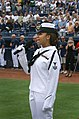US Navy 070322-N-5324D-002 Personnel Specialist 2nd Class Natalie Howe of Navy Operational Support Center (NOSC) Phoenix, sings the National Anthem during a pre-season baseball game between the Chicago Cubs and San Diego Padres.jpg