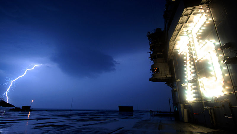 File:US Navy 070502-N-7317W-001 Lightning srikes in the distance as USS Harry S. Truman (CVN 75) is in her homeport.jpg