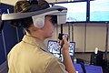 US Navy 070516-N-9241M-006 A Surface Warfare Officer's School (SWOS) student navigates a virtual vessel through a number of simulated hazards in the school's full-mission bridge. Simulators have become a mainstay of training at.jpg