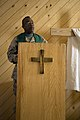 US Navy 070715-M-7772K-024 Harry W. Griffith, attached to Regimental Combat Team (RCT) 2, gives a sermon during a praise and worship service.jpg