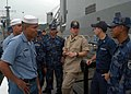 US Navy 070829-N-7029R-011 Electronics Technician 2nd Class Erwin Myers shares ideas with a member of the U.S. Coast Guard and Sailors from the Nicaraguan and Ecuadorian navy on visit, board, search and seizure procedures befor.jpg