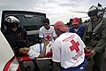 US Navy 070907-N-1810F-021 A woman injured during Hurricane Felix is moved by Nicaraguan Red Cross volunteers from an amphibious assault ship USS Wasp (LHD 1) helicopter, to a local hospital.jpg