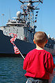 US Navy 070910-N-4995K-013 A young boy waves the flag in anticipation as guided-missile frigate USS Gary (FFG 51) pulls into port.jpg