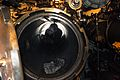 US Navy 080129-N-2555N-313 Information Systems Technician 1st Class Joshua Shepard works inside a torpedo tube aboard the decommissioned World War II-era diesel submarine USS Drum (SS 228) to help prepare the submarine for the.jpg