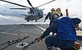 US Navy 080213-N-0807W-175 Sailors prepare to chalk and chain a CH-53E Super Stallion helicopter attached to Medium Helicopter Squadron (HMM) 265 ) to the flight deck of the dock landing ship USS Harpers Ferry (LSD 49) during t.jpg