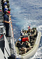 US Navy 080721-N-4236E-002 The visit, board, search, and seizure team from the guided-missile cruiser USS Vella Gulf (CG 72) boards a rigid hull inflatable boat in order to conduct a boarding exercise.jpg