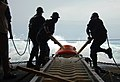 US Navy 080810-N-7643B-001 Deck Department Sailors slide an inert training mine into the sea from the well deck of the amphibious assault ship USS Tarawa (LHA 1) during the multi-national training exercise Fuerzas Aliadas PANAM.jpg