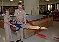 US Navy 081212-N-5086M-006 Rear Adm. Christine S. Hunter, commander of Naval Medical Center San Diego, and Capt. Gregory Blaschke, Medical and Surgical Simulation Center medical director, cut a ribbon.jpg