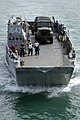 US Navy 090728-N-0924R-023 Landing Craft Unit (LCU) 1643, assigned to Assault Craft Unit (ACU) 2 based in Little Creek, Va., transport an M149 water buffalo trailer back to the amphibious dock landing ship USS Oak Hill (LSD 51).jpg