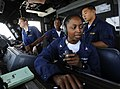 US Navy 090914-N-5345W-045 Boatswain's Mate 3rd Class April Sanders mans the helicopter control tower phone-talker station with Ensign Judith Bates, far left, and Lt. Tamara Sonon.jpg