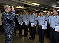 US Navy 100106-N-8273J-078 Chief of Naval Operations (CNO) Adm. Gary Roughead administers the oath of reenlistment to 25 Sailors during a ceremony aboard the aircraft carrier USS Nimitz (CVN 68).jpg