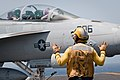 US Navy 100617-N-1928O-177 An aircraft director guides an F-A-18 Hornet.jpg
