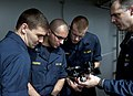 US Navy 110528-N-DR144-901 Master Chief Quartermaster Jonathan Myers teaches midshipmen how to use a sextant for celestial navigation.jpg