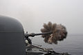 US Navy 110610-N-SP676-307 The guided-missile frigate USS Ford (FFG 54) fires its MK 75 76mm-3-inch gun at a target during a Cooperation Afloat Rea.jpg