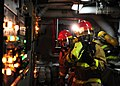 US Navy 111011-N-ED900-240 Fire assessment members use a naval firefighting thermal imager (NFTI) in a main engine room to gauge temperatures durin.jpg