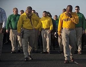 US Navy 120125-N-DR144-525 Master Chief Aviation Boatswain's Mate Raul Castillo, left, and Aircraft Handling Officer Lt. Cmdr. Tommy Edgeworth, wip.jpg