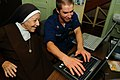 US Navy Information Systems Technician teaches Carmelite Sister to use the Internet.jpg