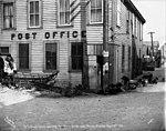 US mail dog sled team resting outside of post office, Nome, Alaska, April 13, 1906 (AL+CA 7524).jpg