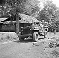 Van de Poll in uniform in een jeep bij Depok in Nederlands-Indië, Bestanddeelnr 254-5372.jpg