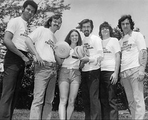 WLS (AM) - WLS disk jockeys at a Frisbee promotion, 1972. From left: Bill Bailey, Chuck Knapp, Charlie Van Dyke, Fred Winston and John Records Landecker.