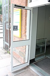 Waiting room door at Bromborough railway station (28545863842).jpg