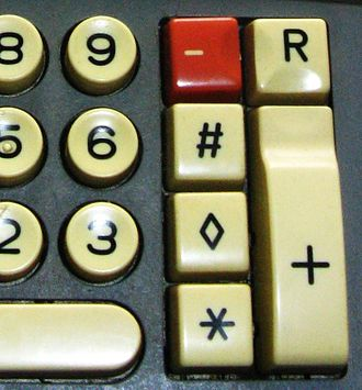 Lozenge - Lozenge (subtotal) key on a Walther Multa 32 calculator keyboard, ca. 1970