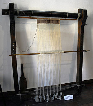 Warp-weighted loom - Warp weighted loom with string heddles in the Central Textile Museum in Łódź, Poland