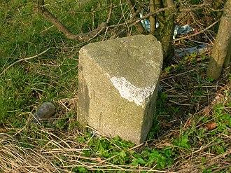 Knockentiber - The Waterpark milestone showing damage from hedgecutting machinery.